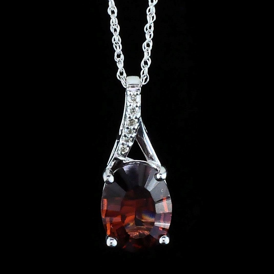 Garnet and Diamond Pendant by Parle